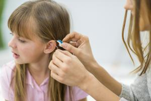 Girl Getting Fitted For Hearing Aid