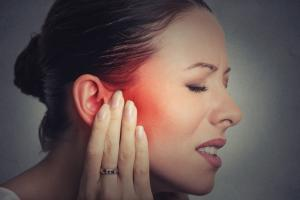 Woman suffering with tinnitus-West Orange, NJ - The Heariing Group