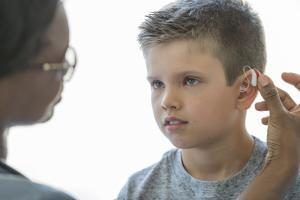 Boy with Hearing Aid -West Orange, NJ - The Hearing Group