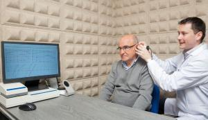 Elderly man visiting an audiologist